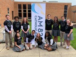 St. Francis DeSales students in front of AM820 sign