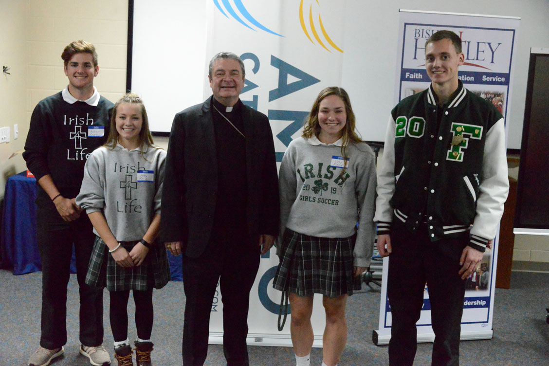 Fisher Catholic High School students with Bishop Brennan