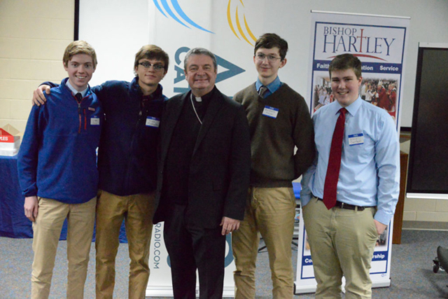 St. Charles Perparatory School students with Bishop Brennan