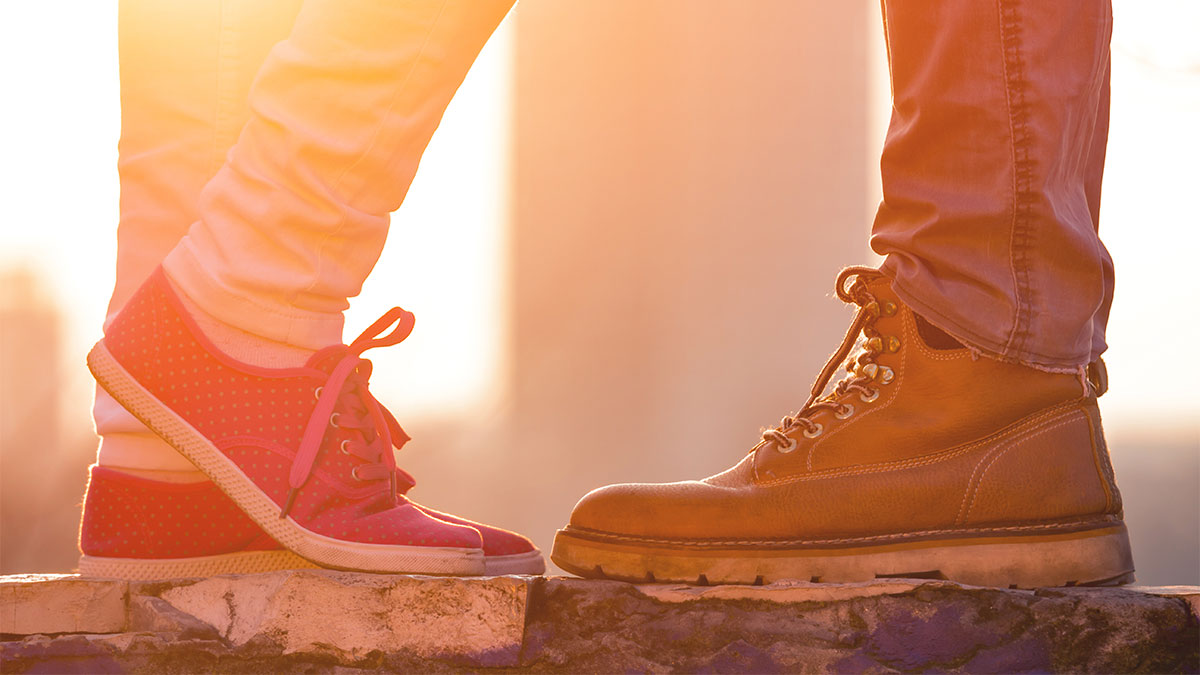 Image of a couple's shoes standing facing eachother