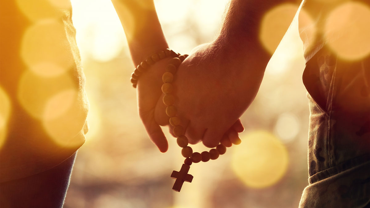 Couple Holding Hands with Rosary
