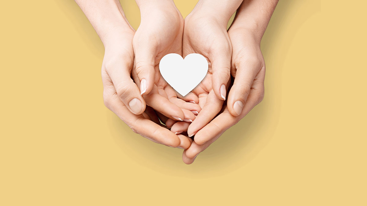 Couples holding heart - conversation about fertility NFP