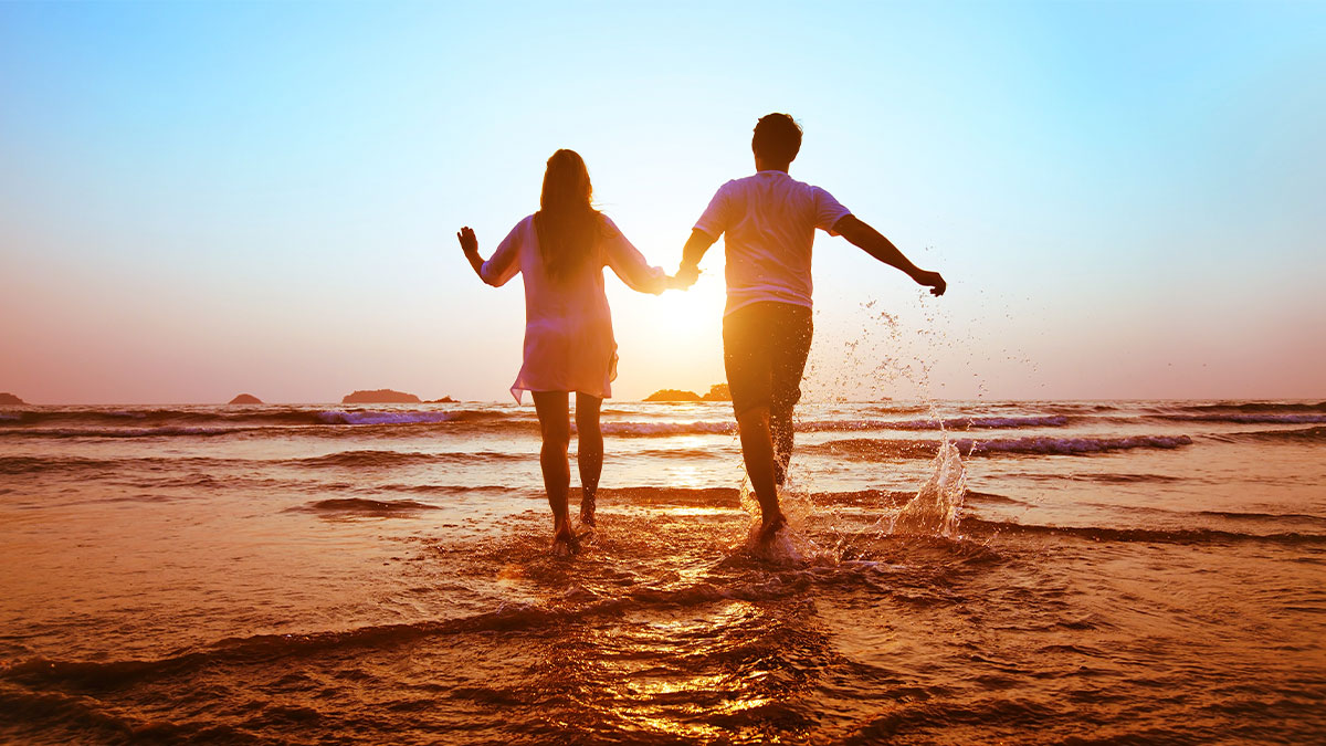 Play - A Virtue to Take Seriously - couple having fun on the beach
